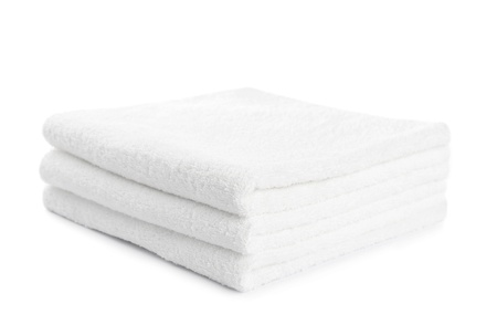 stack of white towels isolated on white Stock Photo