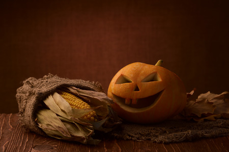 Scary halloween pumpkin jack-o-lantern on dark background Stock Photo