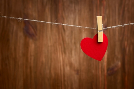 Love heart hanging on wooden texture background, valentines day card concept Stock Photo