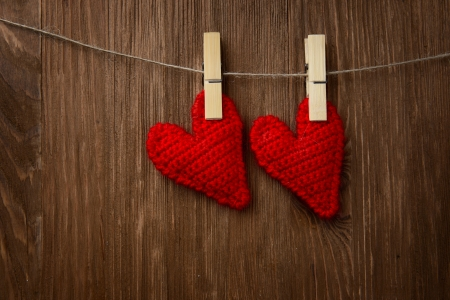 love hearts hanging on wooden texture background, valentines day card concept photo