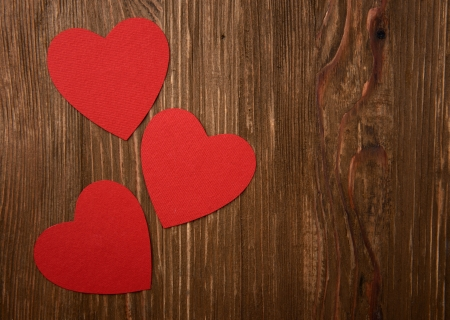 Love hearts on wooden texture background, valentines day card concept