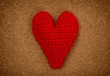 Love heart on pressured cork texture background, valentines day card concept photo