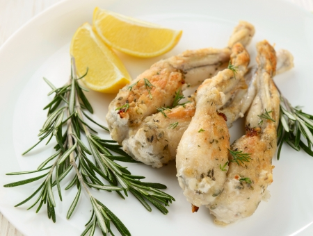 Frogs Legs Fried with Garlic and Herbs and Lemon