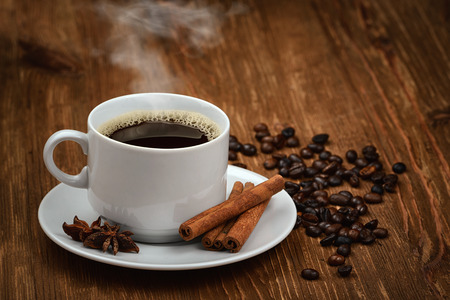 Coffee cup and coffee beans on old wooden background Stock Photo