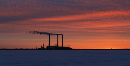 thermal pollution: Smoke billows from a smokestack at a power plant