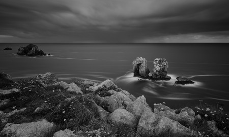 the rocky coasts of northern Spain, Los Urros. Black and white image.