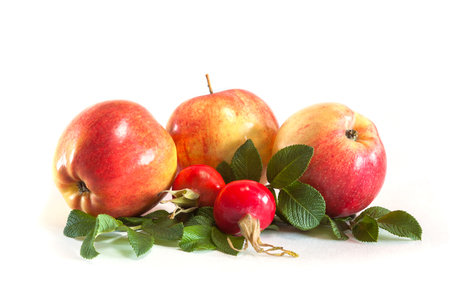 Three apples and rosehips with leaves isolated on white Standard-Bild - 112666008