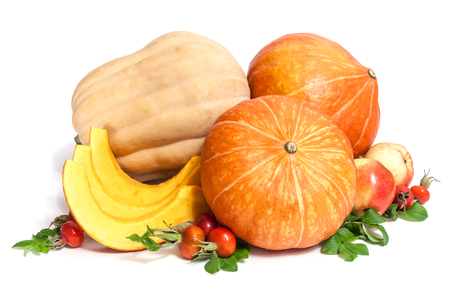 Two orange and one yellow pumpkins with three slices , two apples and rosehips with leaves isolated on white Standard-Bild - 112666025