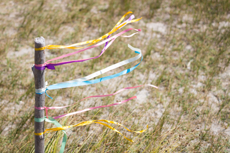 mingled: Colored ribbons fluttering in the wind in the daytime Stock Photo