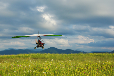 israel farming: Glider flying over the grass during the day