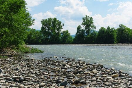 Waves on a mountain river in summer. Caucasus