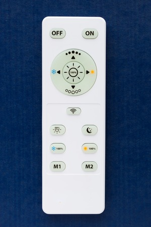 transponder: White remote control on the blue background