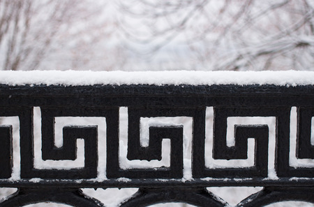 barring: Metallis barring pattern pod with snow in winter Stock Photo