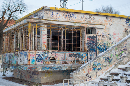 unneeded: Abandoned Cafe with graffiti in the stadium in the daytime Stock Photo
