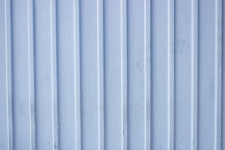 Grey blue painted metal background in the daytime