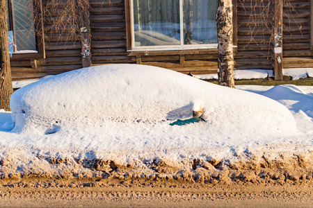 frostily: The car filled up by snow in the daytime