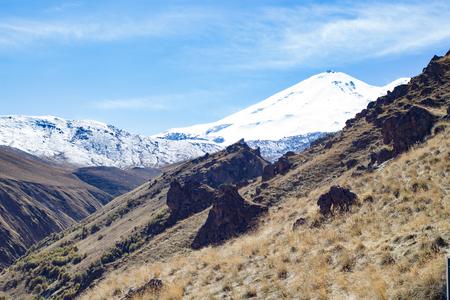 Landscape panorama Elbrus mountain with autumn hills daytime