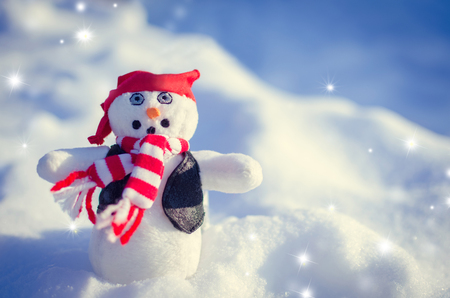 red bandana: Winter concept with snowman rock style on snow background. Dressed with red and white striped scarf, red bandana and leather sleeveless in the snow outside.