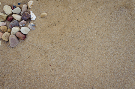 sandy brown: Beautiful sand background with stones. Beach sand background. Sandy texture with stones.. Brown sand. Background from fine sand. Sand background. Summer concept. Top view. Copy space.