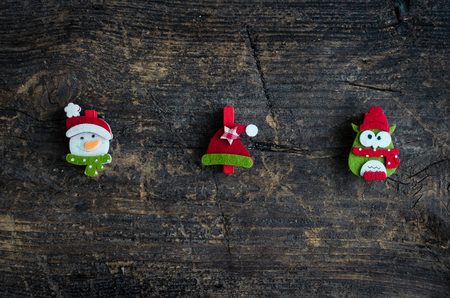 Christmas symbols snowman, owl and winter hat on an old wooden background with place for text. Christmas decoration. Xmas time background. Winter holidays. Christmas concept. Top view. Copy space.