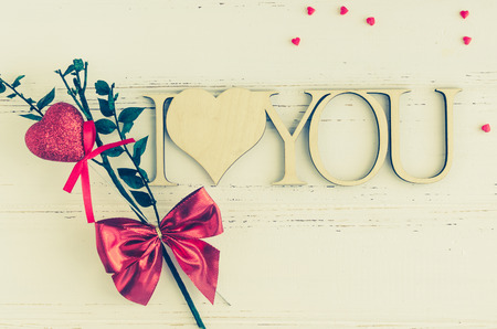 I Love You - wooden phrase on white shabby chic background. Valentines Day theme. Romantic love Valentines concept. Copy space. Stock Photo
