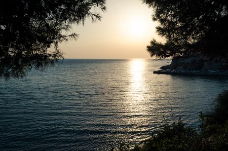 Beautiful sunset view on sea and Stadi Grad - old town of Ulcinj at twilight scene. Coast of Adriatic sea. Montenegro.