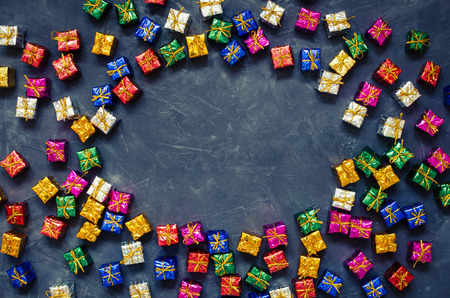 Background with small colorful presents. Colorful gift boxes. Online shopping concept Black Friday and Ciber Monday. Copy space. Top view. Flat lay. Foto de archivo - 121073260