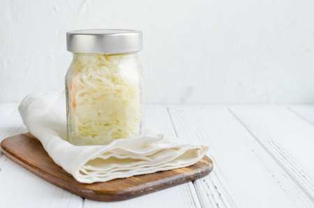 Homemade sauerkraut village fermented cabbage. Vegan salad rustic style glass jar. Fermented food great for good health. Traditional rustic winter food. Probiotics food concept. Banco de Imagens