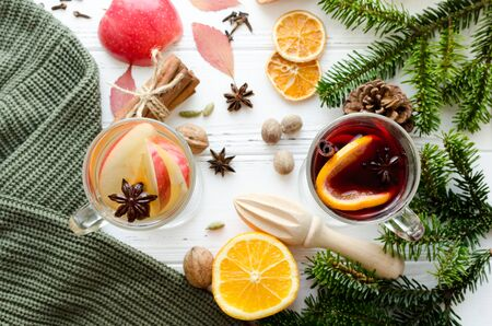 Autumn and Christmas mulled wine or gluhwein based on red and white wine with spices and ingredients on white wooden background. seasonal and holidays concept. Christmas and autumn theme. Top view.