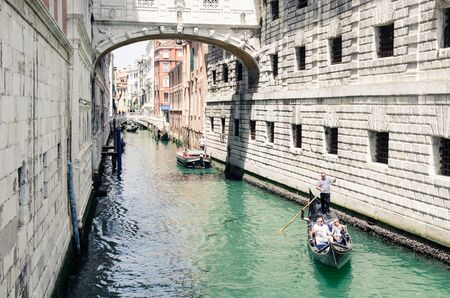Venice, Italy - Sightseeing place of famous travel destination. Scenic canal with gondola.