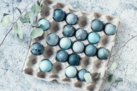 Blue Easter eggs. Easter composition on grey concrete background. Natural ecological staining with food coloring. Top view.