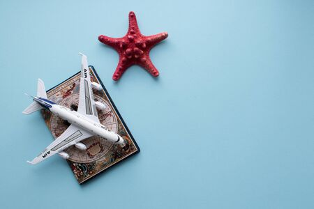 Vacation concept. Passport and plane on blue Stock fotó