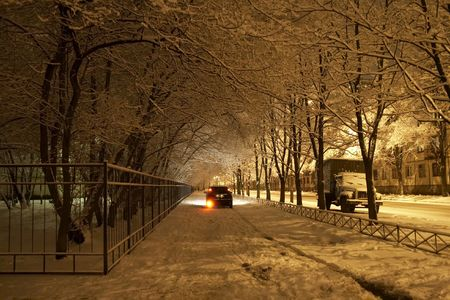 Winter evening and the machine leaving on sidewalk Stock Photo - 3374798