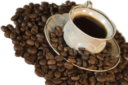 Tazza di caff� e grano su uno sfondo bianco