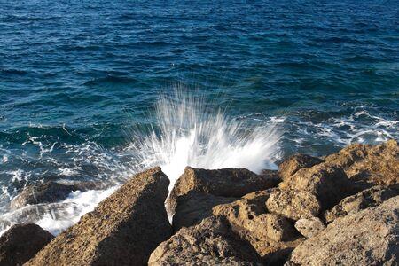 splashing waves off the coast photo