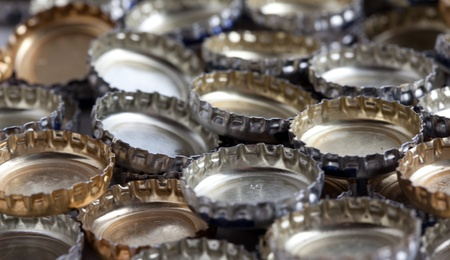 Beer bottle caps in a pile