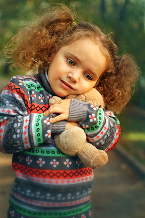3 persons only: Little girl in the autumn park Stock Photo