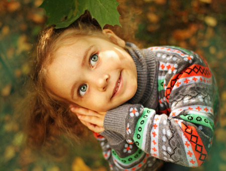 Little girl in the autumn park Stock Photo