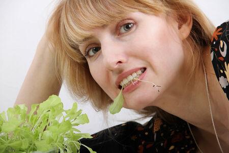 young woman eating fresh salad