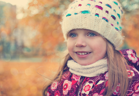portrait of a girl in a scarf and hat. Autumn. Toning