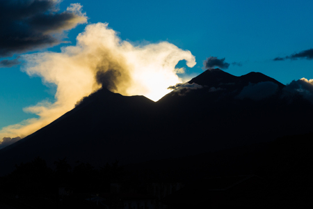 explotion: Acatenango Volcano and Fire Volcano during the sunset in November.
