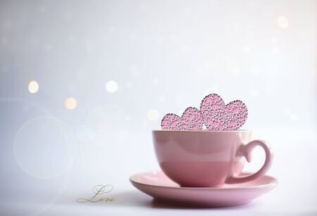 Pink porcelain cup of tea coffee with icons of two pink hearts and word LOVE on white background with cicrcles. Card, poster, mock up. Celebrating, love, anniversary, birthday, valentins concept.