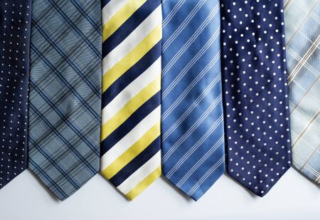 Many different colorful ties, on white background