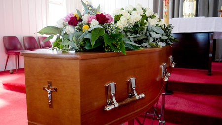 closeup shot of a colorful casket in a hearse or chapel before funeral