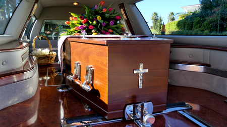 closeup shot of a colorful casket in a hearse before funeral