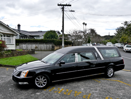 Shot of hearse arriving for a funeral Stock Photo