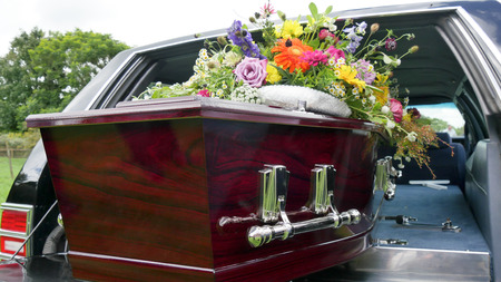 closeup shot of a colorful casket in a hearse or chapel before funeral or burial at cemetery