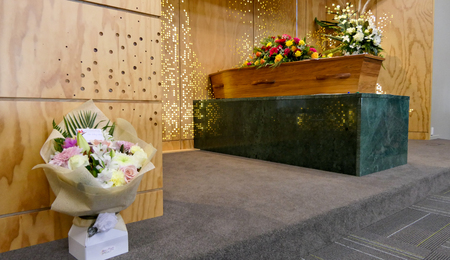 closeup shot of a colorful casket in a hearse or chapel before funeral or burial at cemetery Archivio Fotografico - 99336058