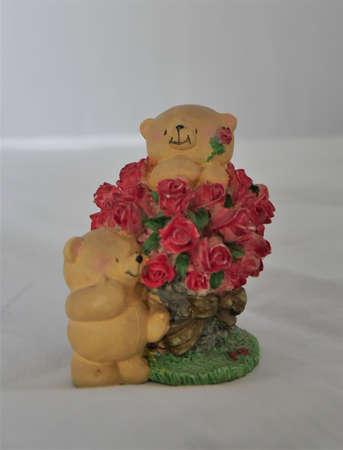 Ceramic statue antique teddy bear doubling up as piggy bank Foto de archivo