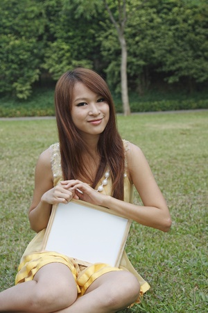gril: Happy Asian gril holding blank whiteboard Stock Photo